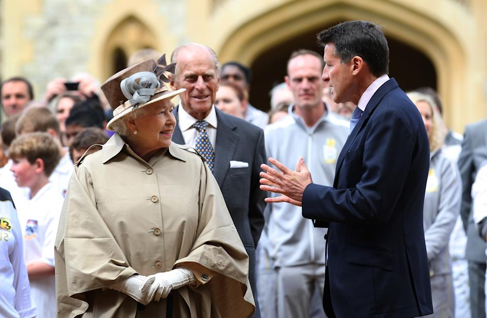 This image made available by LOCOG shows Queen Elizabeth II and Prince Philip meeting Olympic chairman Sebastian Coe, right, outside Windsor Castle, Windsor, England Tuesday July 10, 2012.    (AP Photo/Chris Radburn/LOCOG)