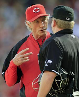Cincinnati Reds acting manager Chris Speier, left, questions a call with home plate umpire Mike Muchlinski during a baseball game against the Los Angeles Dodgers, Saturday, Sept. 22, 2012, in Cincinnati. Reds manager Dusty Baker remained in a Chicago hospital after experiencing an irregular heartbeat. (AP Photo/Al Behrman)