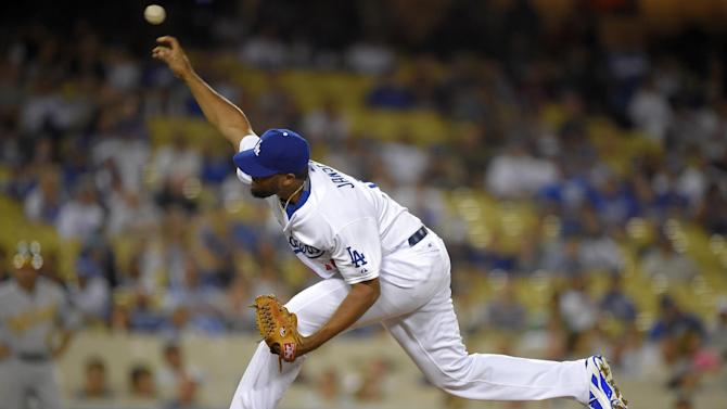 Los Angeles Dodgers relief pitcher Kenley Jansen throws to the plate during the ninth inning of a baseball game against the Oakland Athletics, Wednesday, July 29, 2015, in Los Angeles. (AP Photo/Mark J. Terrill)