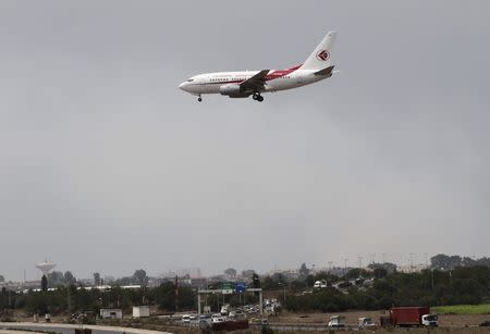 An Air Algerie Airways plane prepares to land at Houari Boumediene Airport in Algiers