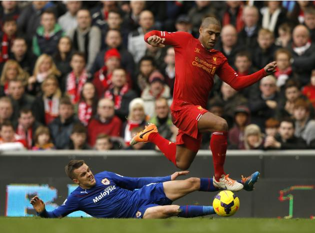 Liverpool's Johnson challenges Cardiff City's Noone during their English Premier League soccer match at Anfield in Liverpool