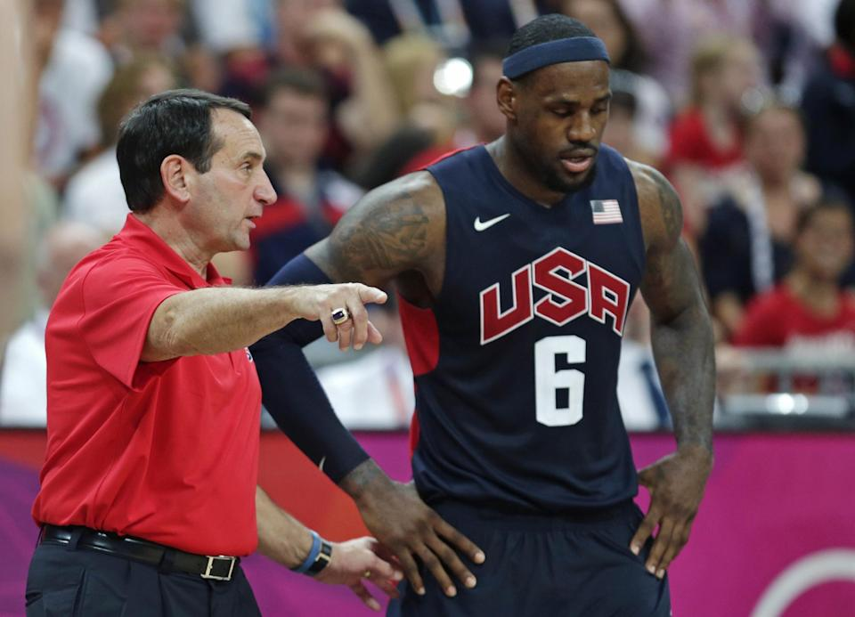 USA coach Mike Krzyzewski talks with LeBron James during a men's basketball game against Lithuania at the 2012 Summer Olympics, Saturday, Aug. 4, 2012, in London. (AP Photo/Charles Krupa)