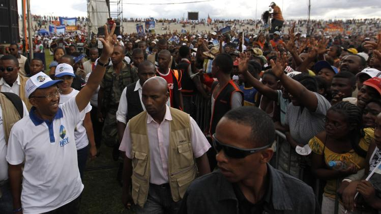 Rakotoarimanana waves to his supporters as he arrives for his final campaign rally in Antananarivo