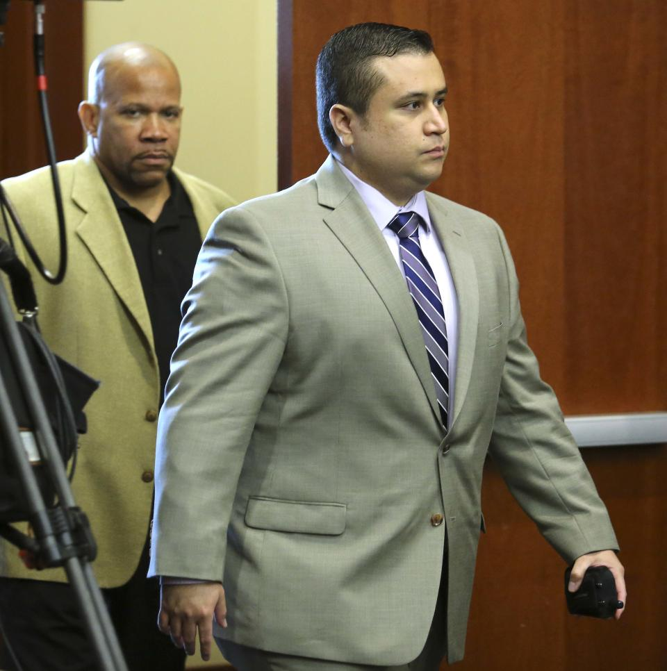 Accompanied by his bodyguard, George Zimmerman, accused in the Trayvon Martin shooting, returns to court after a recess at the Seminole County courthouse, in Sanford, Fla., Saturday morning, June 8, 2013. (AP Photo/Orlando Sentinel, Joe Burbank, Pool)