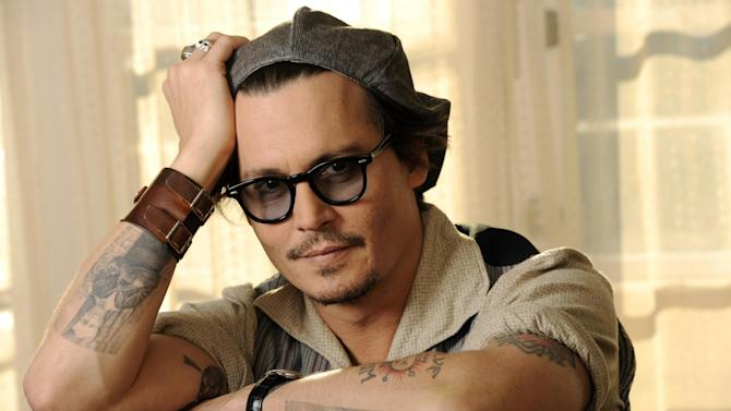 """FILE - In this Oct. 12, 2011 file photo, Johnny Depp, a cast member in the film """"The Rum Diary,"""" poses for a portrait in Beverly Hills, Calif. In San Diego, fans at Comic-Con on Thursday, July 12, 2012, got the first look at """"The Lone Ranger,"""" which stars Depp, set for release next summer. (AP Photo/Chris Pizzello, File)"""
