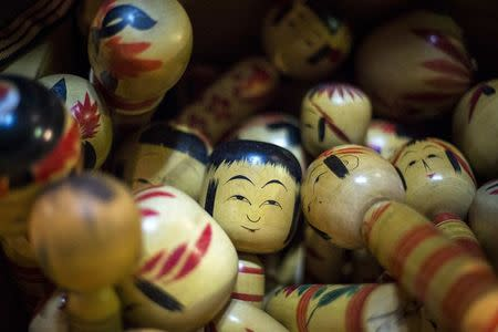 Traditional Kokeshi dolls from Japan's northern Tohoku area are piled up in a box at Boroichi flea market in Tokyo