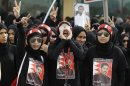 Protesters protest during a rally by Al Wefaq in Budaiya, west of Manama
