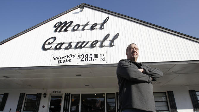FILE -In this Wednesday, Nov. 9, 2011 file photo, owner Russ Caswell stands outside his Motel Caswell in Tewksbury, Mass. Caswell is fighting to keep the federal government from taking his motel under a law that allows for forfeiture of properties connected to crimes. The government does not claim that Caswell committed any crimes, but claims there is drug-dealing among the motel's guests.  (AP Photo/Winslow Townson, File)