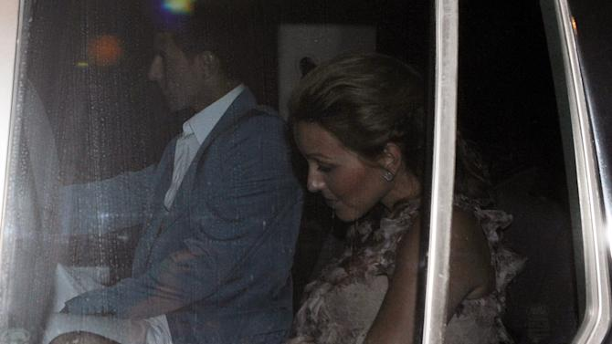 Tennis player Novak Djokovic (L) and his girlfriend Jelena Ristic arrive to a pre-wedding party at the luxurious Adriatic resort of Sveti Stefan on July 9, 2014