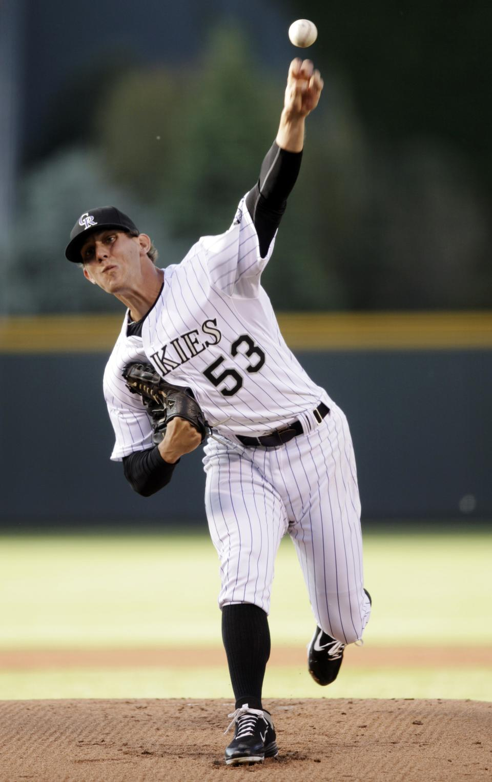 Colorado Rockies starting pitcher Christian Friedrich delivers against the Houston Astros in the first inning of a baseball game, Wednesday, May 30, 2012, in Denver. (AP Photo/Joe Mahoney)