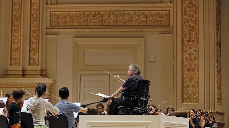 Metropolitan Opera Music Director James Levine conducts the MET Orchestra on May 18, 2013 during a rehearsal at Carnegie Hall. The Sunday, May 19 concert by the MET Orchestra at Carnegie Hall will mark Maestro Levine's first public performance in more than two years after being sideline by a spinal injury. The concert will be broadcast live on SIRIUS XM Channel 74 and streamed on the Met's Web site (metopera.org) beginning at 2:55 p.m. (AP Photo/Metropolitan Opera, Cory Weaver)