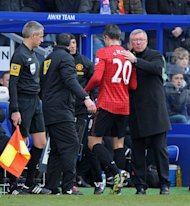 Manchester United&#39;s Dutch striker Robin van Persie is substituted after picking up an injury in the 2-0 win at QPR, on February 23, 2013. Van Persie tumbed into the photographers&#39; pit behind one goal, sustaining a hip injury that forced him off four minutes before half-time