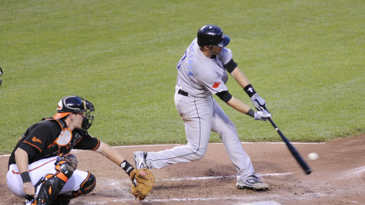 Toronto Blue Jays' J.P. Arencibia connects for a grand slam off Baltimore Orioles Zach Britton in the fifth inning of a baseball game, Friday, June 3, 2011, in Baltimore. Also pictured is Orioles catcher Matt Wieters. (AP Photo/Gail Burton)