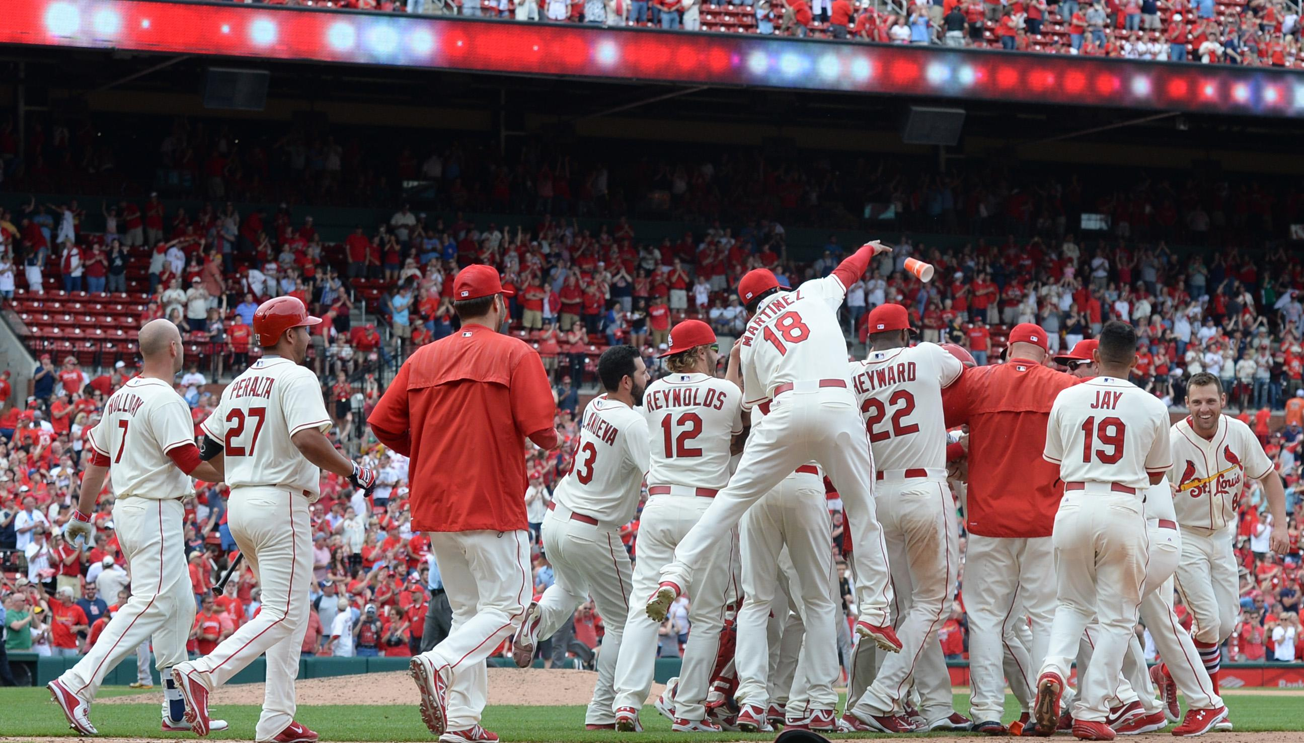 Cards again beat Pirates 2-1 in extras, win in 11th