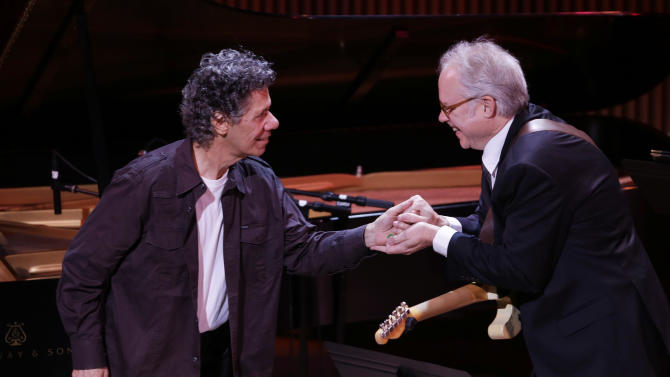 Chick Corea, left, greets guitarist Bill Frisell before they performed together during the opening night concert of the SFJAZZ Center Wednesday, Jan. 23, 2013 in San Francisco. The 700-seat, specially designed concert hall nestled in the heart of the city's arts district attracted a crowd of hundreds with a high-energy, inaugural celebration emceed by Bill Cosby. Billed as the first freestanding building in the West built for jazz performance and education, the center opened Wednesday after raising more than $60 million over more than a decade to build a home for SFJAZZ, the nonprofit that puts on the city's jazz festival. (AP Photo/Eric Risberg)