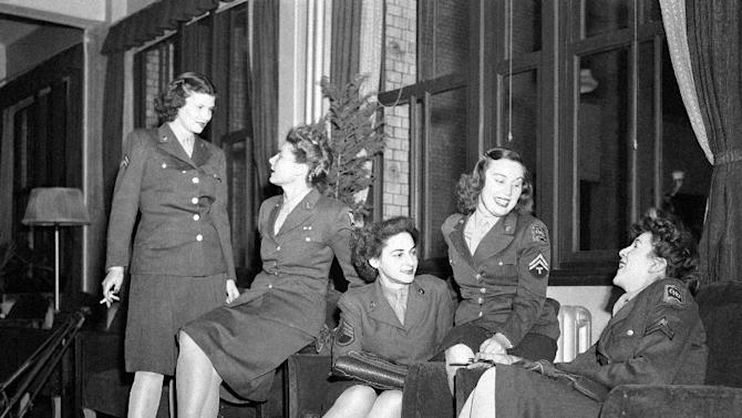 FILE - In this March 1947 file photo, a group of Women Army Corps (WAC) personnel pose in a Tokyo lounge. (AP Photo, File)