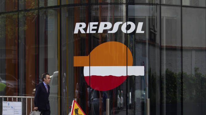 A man walks past a Repsol gas station in Madrid, Wednesday April 18, 2012. Argentina's takeover of its top energy company from Spain's Repsol might solve the country's short-term energy needs, and it thrills Argentines who blame privatizations for their economy's collapse a decade ago. But analysts say it sends a terrible signal to anyone wanting to invest in Argentina. President Cristina Fernandez made Spain furious by decreeing that her government will recover YPF by expropriating Repsol's majority stake in the company. (AP Photo/Paul White)