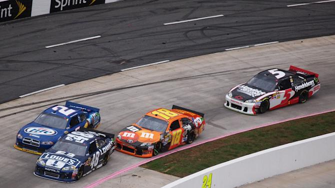 Jimmie Johnson (48) takes the lead from Brad Keselowski (2) during the NASCAR Sprint Cup Series auto race at Martinsville Speedway, Sunday, Oct. 28, 2012, in Martinsville, Va. (AP Photo/Steve Sheppard)
