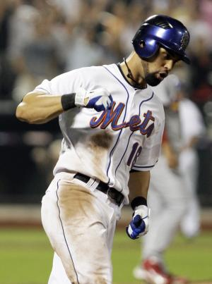 New York Mets' Angel Pagan reacts after hitting a walk-off home run in the tenth inning of a baseball game against the St. Louis Cardinals, Wednesday, July 20, 2011, at Citi Field in New York. The Mets won 6-5. (AP Photo/Frank Franklin II)