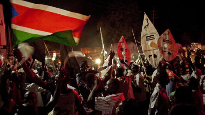 Southern Sudanese celebrate independence at midnight in Juba, Saturday, July 9, 2011. South Sudan became the world's newest nation early Saturday, officially breaking away from Sudan after two civil wars over five decades that cost the lives of millions. (AP Photo/Pete Muller)
