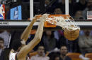 Milwaukee Bucks center John Henson (31) dunks against the Miami Heat during the first half of an NBA basketball game in Miami, Tuesday, Jan. 27, 2015. (AP Photo/Alan Diaz)