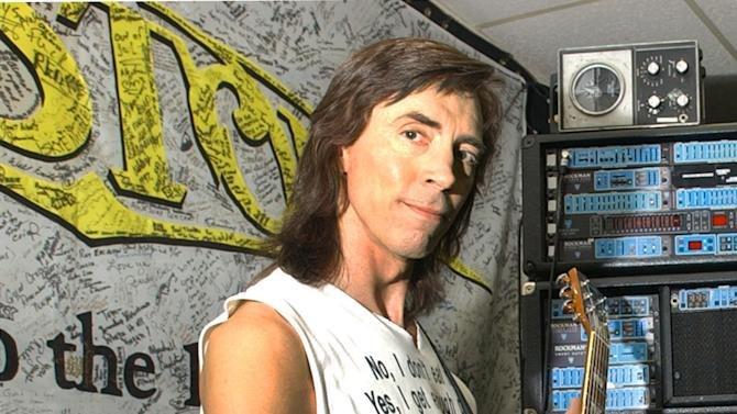 FILE - This Nov. 21, 2002 file photo shows Tom Scholz, co-founder of the band Boston, in a recording studio in Waltham, Mass. A defamation lawsuit filed by Scholz against Micki Delp, the ex-wife of the band's late lead singer Brad Delp, was reinstated Tuesday, May 14, 2013, by the Massachusetts Appeals Court. Delp committed suicide in 2007, and Scholz claimed that remarks Micki Delp made to the Boston Herald could be construed as blaming Scholz for his death. (AP Photo/Elise Amendola, file)