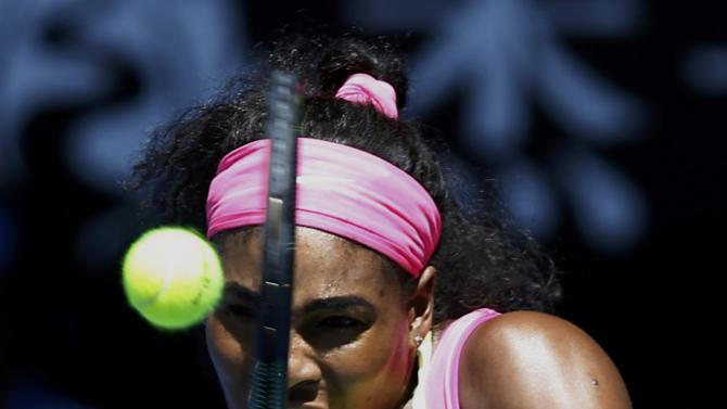 Williams of the U.S. hits a return to Muguruza of Spain during their women's singles fourth round match at the Australian Open 2015 tennis tournament in Melbourne