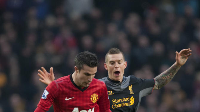 Manchester United's Robin van Persie, left, keeps the ball from Liverpool's Daniel Agger during their English Premier League soccer match at Old Trafford Stadium, Manchester, England, Sunday Jan. 13, 2013. (AP Photo/Jon Super)