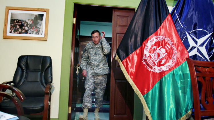 FILE - In this Wednesday, March 9, 2011 file photo, Gen. David Petraeus, then top commander of U.S. and NATO forces in Afghanistan, arrives for an interview at the NATO's head quarter in Kabul, Afghanistan. Nearly two dozen generals have commanded troops from the United States and the NATO-led International Security Assistance Force, since the American invasion in late 2001. While some analysts say fresh eyes are important, others wonder if the revolving door command has hurt U.S. continuity with critical Afghan partners. (AP Photo/Musadeq Sadeq, File)