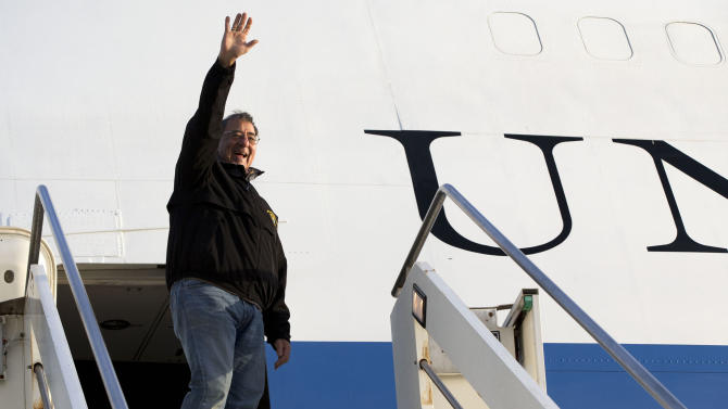 U.S. Defense Secretary Leon Panetta waves goodbye as he departs Rome en route to Vincenza, Italy on Thursday, Jan. 17, 2013. Panetta was in Rome as part of a weeklong swing across Europe, meeting with defense ministers to talk about ongoing conflicts in Afghanistan and Mali. This is expected to be Panetta's last overseas trip as Pentagon chief, as he long has planned to step down once his replacement is confirmed. (AP Photo/Jacquelyn Martin)