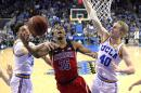 Arizona guard Allonzo Trier, center, shoots as UCLA guard Lonzo Ball, left, and center Thomas Welsh defend during the second half of an NCAA college basketball game, Saturday, Jan. 21, 2017, in Los Angeles. Arizona won 96-85. (AP Photo/Mark J. Terrill)