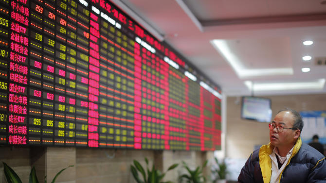 An invested looks at the stock price monitor at a private securities company Tuesday Nov. 19, 2013 in Shanghai, China. World stocks were muted Tuesday as a string of record highs on Wall Street instilled caution about a possible bubble in stock markets fueled by easy monetary policy. China's Shanghai Composite Index dropped 0.2 percent to 2,193.13. (AP Photo)