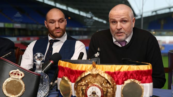 Tyson Fury with trainer Peter Fury during the press conference