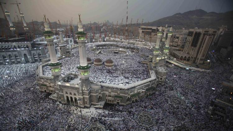 Muslim pilgrims pray at Grand mosque in holy city of Mecca, ahead of annual haj pilgrimage