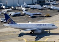A United Airlines Airbus A319 airplane waits on a taxiway to takeoff alongside private jets at John Wayne Airport in Santa Ana, California in February 2012. European planemaker Airbus announced Monday it would open its first US assembly plant in Mobile, Alabama, and single-aisle passenger planes were expected to roll out in 2016