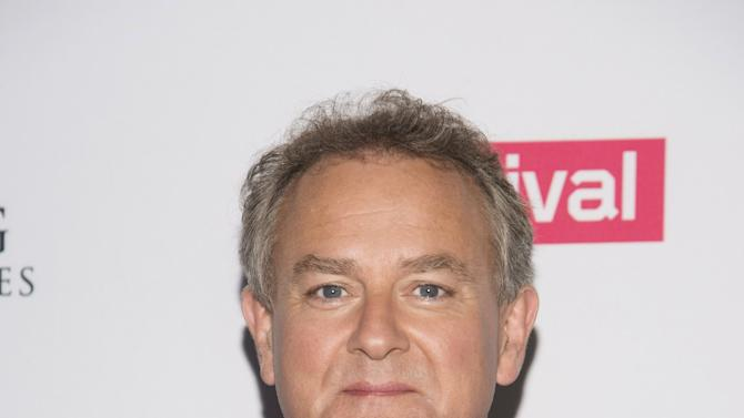 "Hugh Bonneville attends a photo call for ""Downton Abbey"" cast members in Beverly Hills, California"