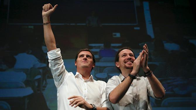Ciudadanos party leader Rivera and Podemos (We Can) party leader Iglesias attend a debate at Carlos III University in Leganes, outside Madrid