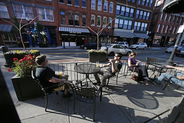 People enjoy drinks with a view of Washington Street at the Tap Brewing Company in Haverhill, Mass. (AP Photo/Elise Amendola)