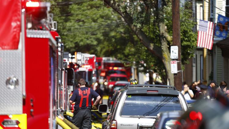 Boston firefighters respond to a two-house fire between Sumner and Webster Streets in East Boston, Massachusetts