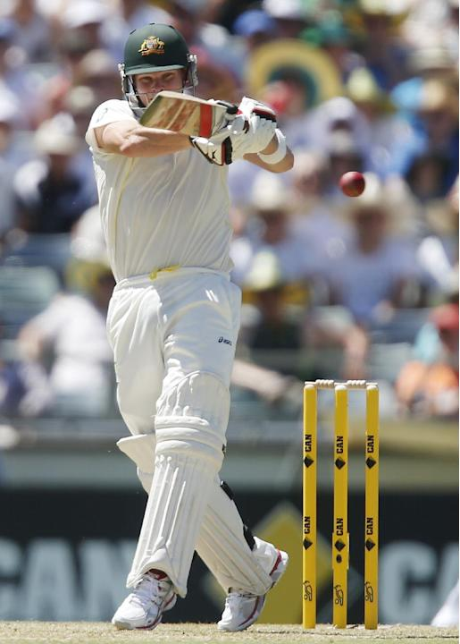 Australia's Steve Smith plays a hook shot against England on the first day of their Ashes cricket test match in Perth, Australia, Friday, Dec. 13, 2013