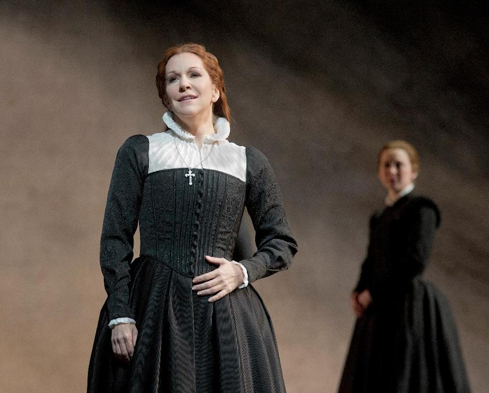 "In this Dec. 24, 2012 photo provided by the Metropolitan Opera, Joyce DiDonato, left, plays Maria Stuarda during a dress rehearsal of Donizetti's ""Maria Stuarda,"" at the Metropolitan Opera in New York. (AP Photo/Metropolitan Opera, Ken Howard)"