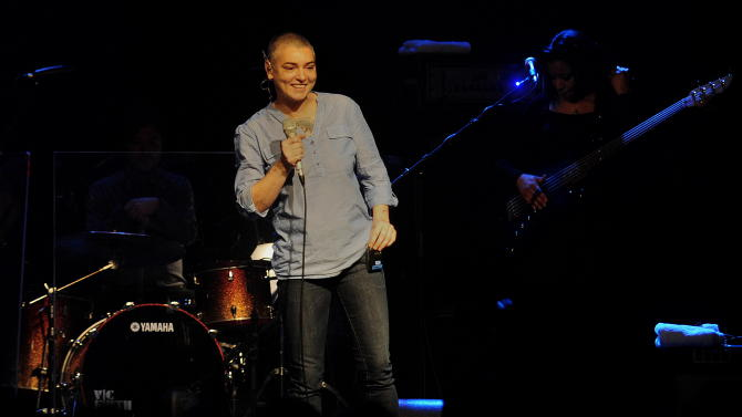 """In this April 18, 2012 photo, Irish singer Sinead O'Connor is shown during an appearance in Colone, Germany. O'Connor says she has to cancel her tour commitments for 2012 due to her bipolar disorder. The singer made the announcement Monday, April 23, in a posting on her Website. She wrote that she is """"very unwell"""" and had been advised by her doctor to not hit the road after her """"very serious breakdown between December and March.""""  (AP Photo/dapd, Mark Keppler)"""