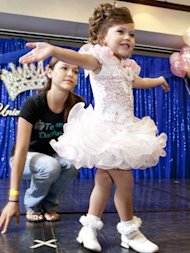 A young contestant practices her walk