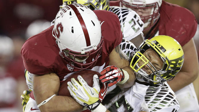 Stanford running back Tyler Gaffney, left, runs against Oregon linebacker Rodney Hardrick (48) during the second quarter of an NCAA college football game in Stanford, Calif., Thursday, Nov. 7, 2013. (AP Photo/Marcio Jose Sanchez)