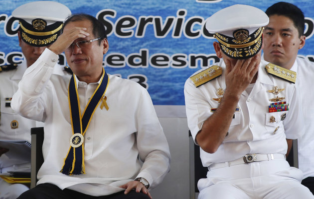 Philippine President Aquino and Navy chief Vice Admiral Jose Luis Alano attend ceremonies marking the Philippine Navy's 115th anniversary in Fort San Felipe