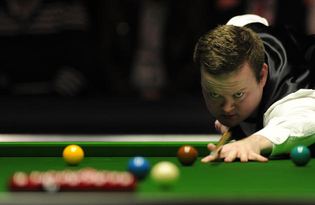 Shaun Murphy of England plays a shot against John Higgins of Scotland during the semi-final match in the BGC Masters snooker tournament at Alexandra Palace in north London on January 21, 2012. AFP PHO