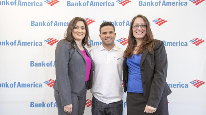 IMAGE DISTRIBUTED FOR BANK OF AMERICA - Elizabeth Romero, left, Jose Altuve, and Danielle Mason are seen at a Bank of America banking center at on Monday, Nov. 24, 2014 in Houston. Houston Astros All-Star second baseman Jose Altuve teamed up with Bank of America to showcase the unique combination of technology, speed and convenience of the bank's newest offering, ATM with Teller Assist, ahead of the busy holiday shopping season. (Photo by Eric Kayne/Invision for Bank of America/AP Images)