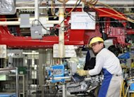 A worker of Fuji Heavy Industries assembles a car on the production line of Subaru BRZ and Toyota 86 at Subaru&#39;s Gunma factory in Gunma prefecture, in March. Japan&#39;s industrial production rose by a slower-than-expected 0.2 percent in April from the previous month, according to the latest data