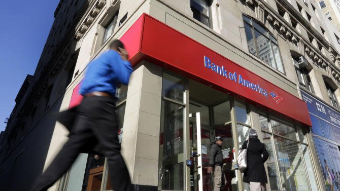 People pass a Bank of America brach, in New York,  Monday, Jan. 7, 2013. Bank of America will pay $10.3 billion to the government mortgage agency Fannie Mae to settle claims resulting from mortgage-backed investments that soured during the housing crash.  (AP Photo/Richard Drew)