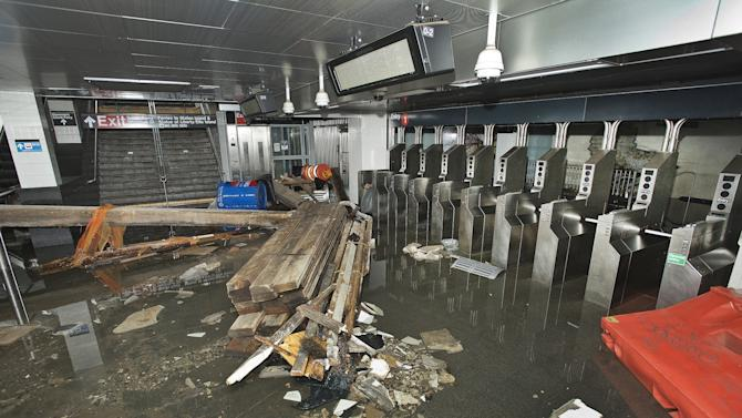 FILE - In this Oct. 30 2012 file photo provided by the Metropolitan Transportation Authority, the South Ferry subway station in New York City is filled with seawater and debris from Superstorm Sandy. Nearly 4 out of 5 Americans now think temperatures are rising and that global warming will be a serious problem for the United States if nothing is done about it, a new Associated Press-GfK poll finds. Belief and worry about climate change are inching up among Americans in general, but concern is growing faster among people who don't often trust scientists on the environment. In follow-up interviews, some of those doubters said they believe their own eyes as they've watched thermometers rise, New York City subway tunnels flood, polar ice melt and Midwestern farm fields dry up. (AP Photo/ Metropolitan Transportation Authority, File)